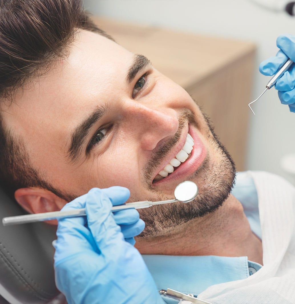 smiling man at the dentist