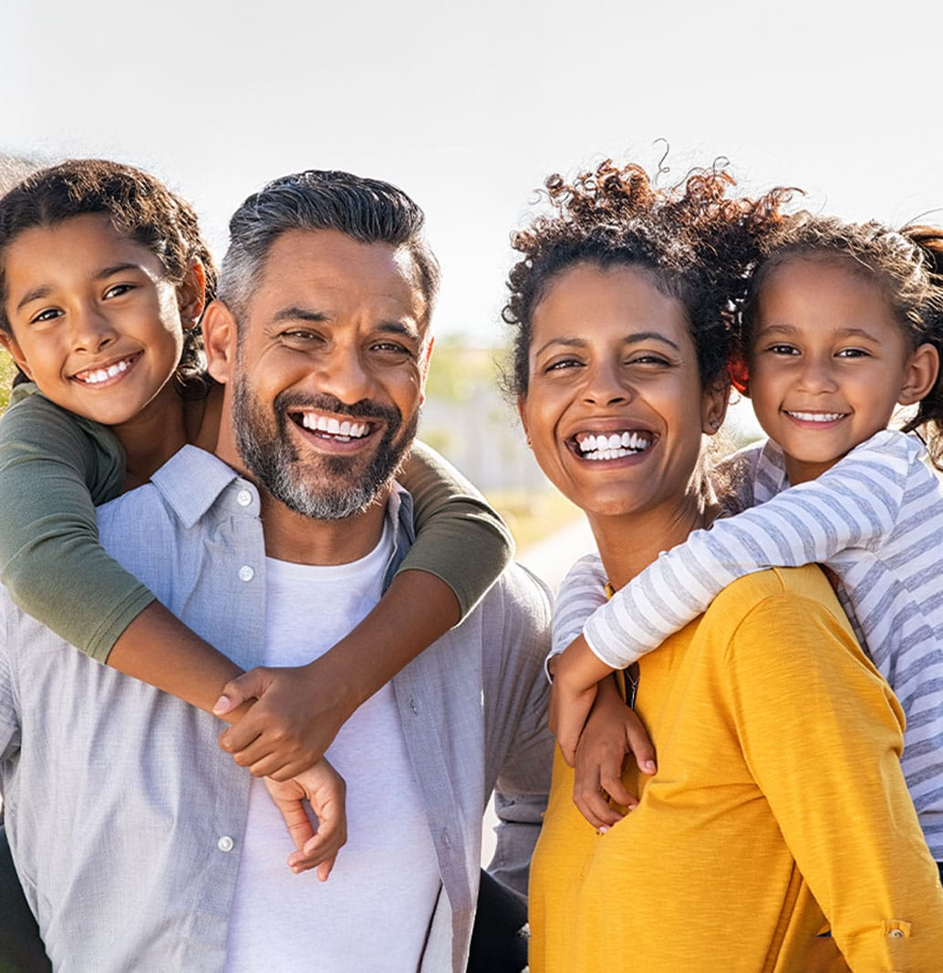 smiling family that has been to the dentist